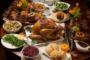 A table filled with tasty Thanksgiving food.